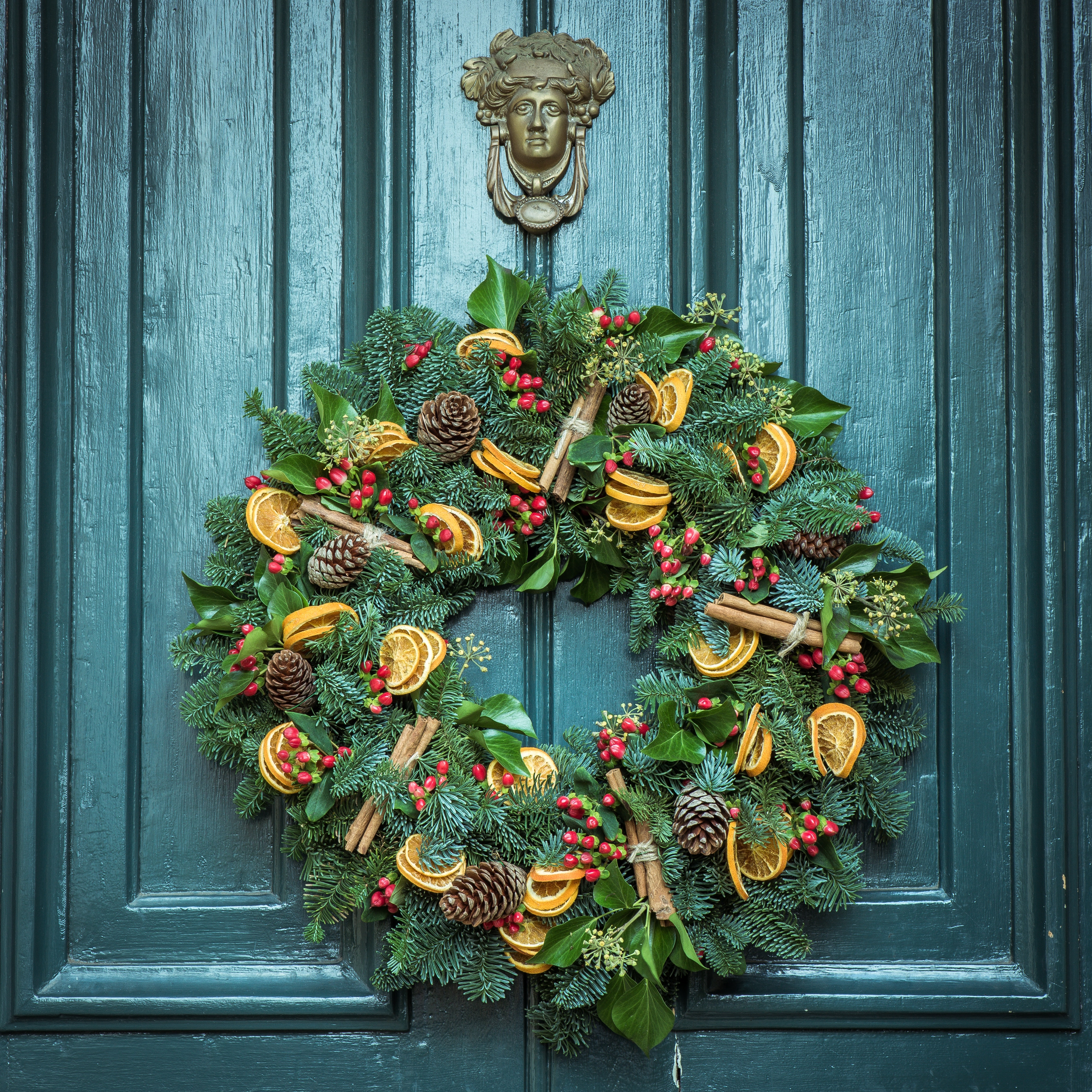 Christmas foliage wreath on door free stock photo
