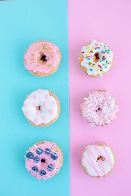 Doughnuts on turquoise and pink backgrounds