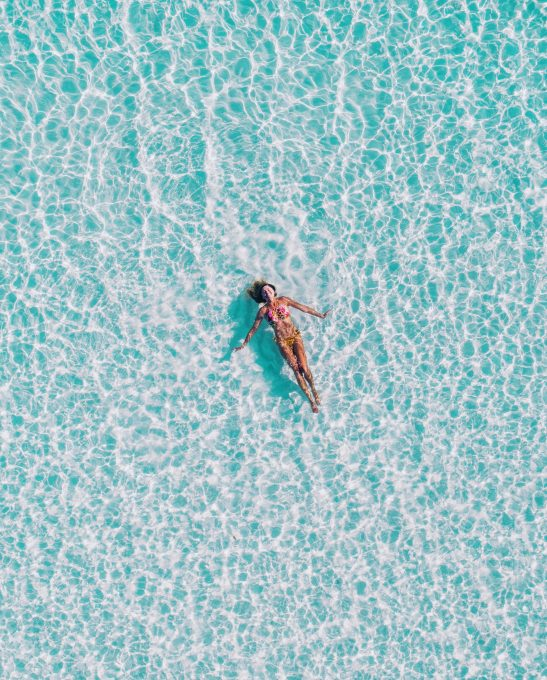 Top view of a pool with woman free stock photo