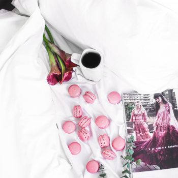 macarons and coffee on a bed free stock photo