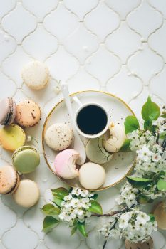 Macarons with coffee cup. Top view free stock photo