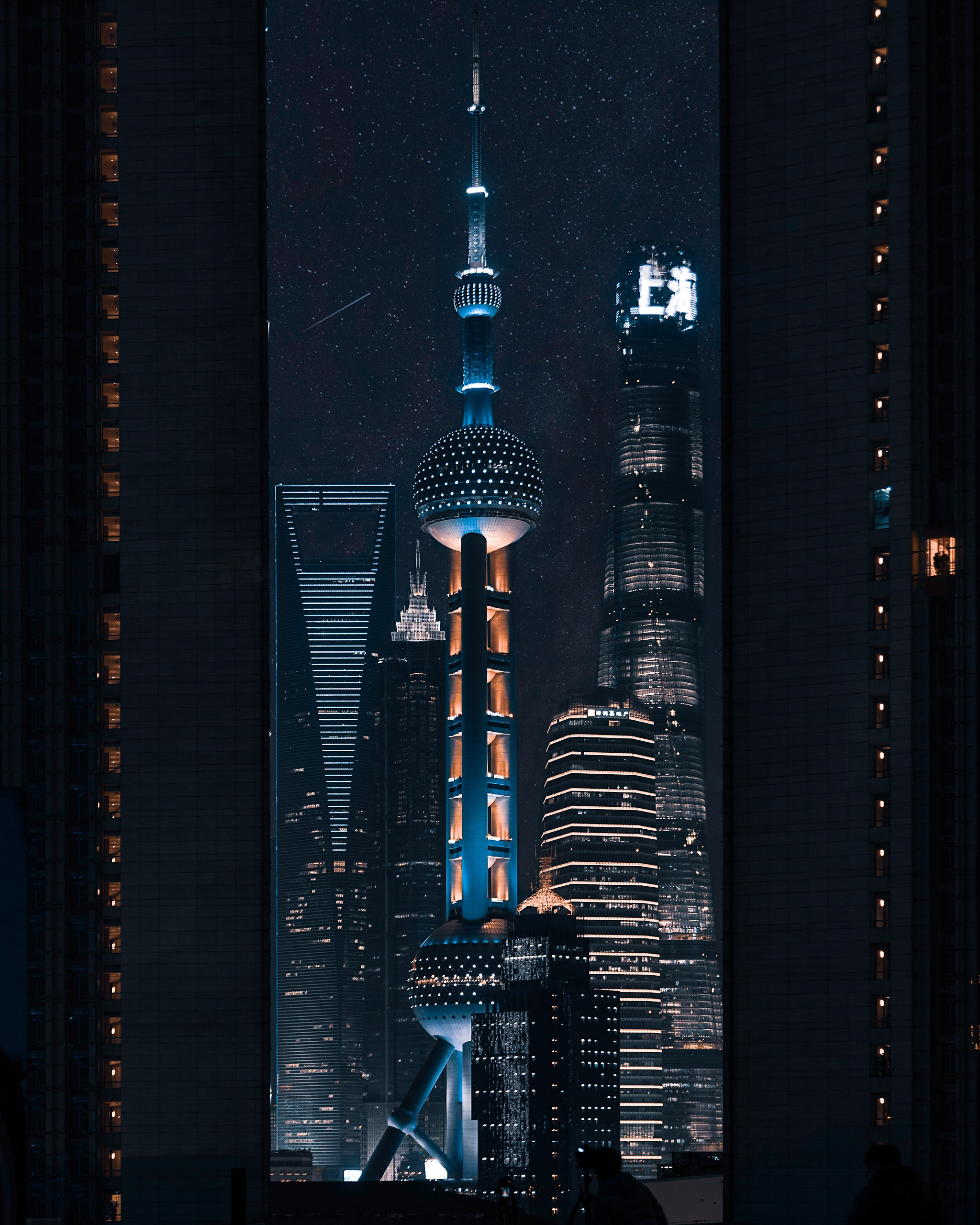 A lighted tower beside a building