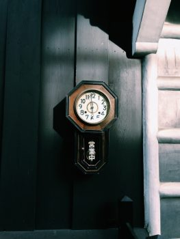 A photo of an antique analog wall clock