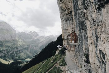 A restaurant on a mountainside during cloudy weather