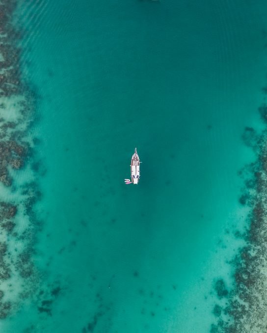 Aerial view of a white boat floating on the water