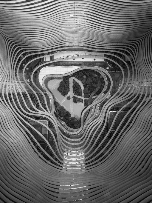 Drone photography of a garden in the middle of curvy steel patterns
