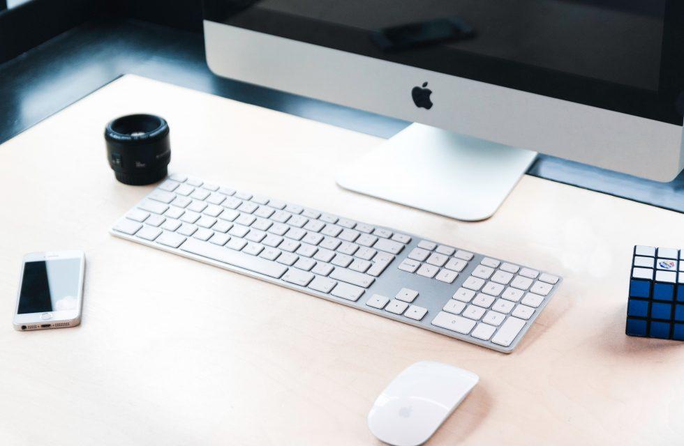 Imac beside Apple Wireless Keyboard and Magic Mouse