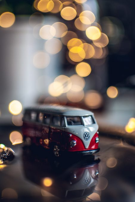 Photo of a red and white toy Volkswagen Van