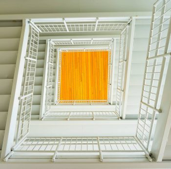 Photo of a white square spiral staircase