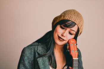 Photography of a woman holding ukulele