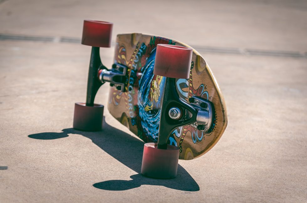 Shallow focus photography of a brown and blue skateboard
