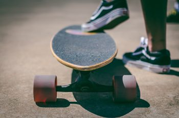 Shallow focus photography of a longboard