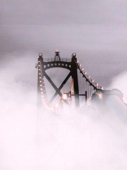 Suspension bridge covered with fog