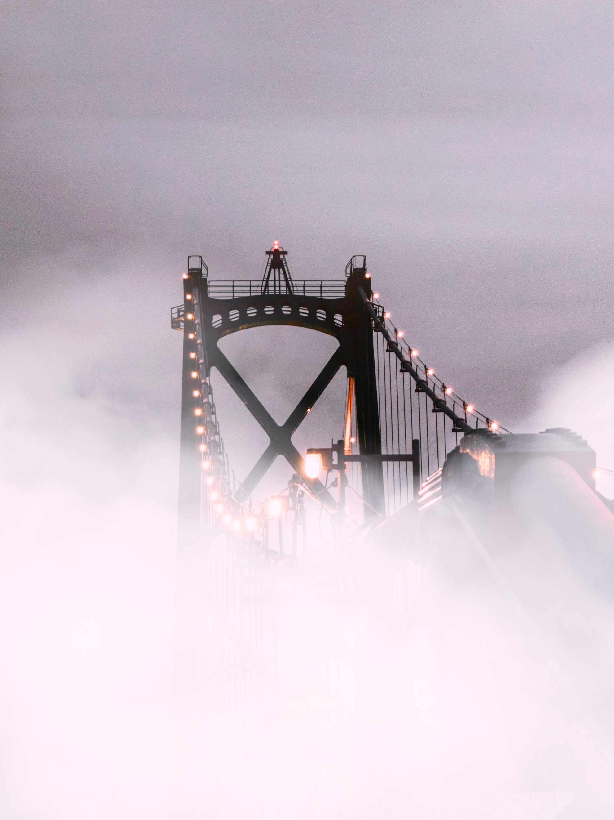 Suspension bridge covered with fog