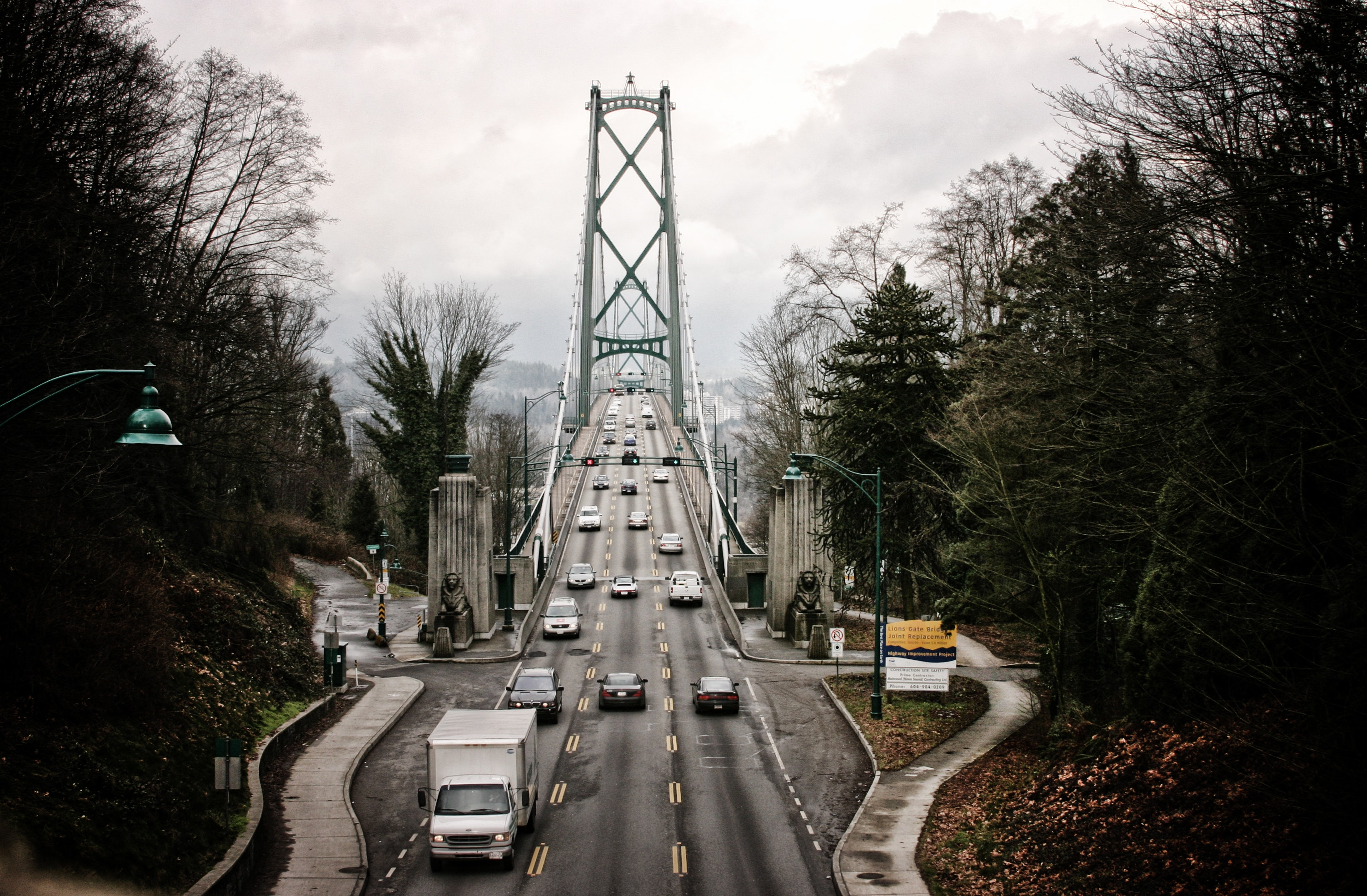 Traffic flowing over a bridge during cloudy weather