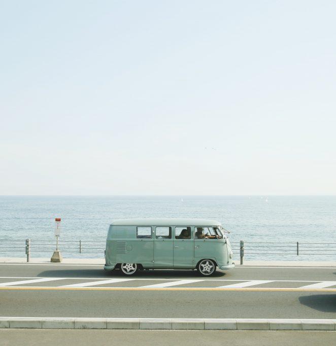 Van parked beside the road near ocean
