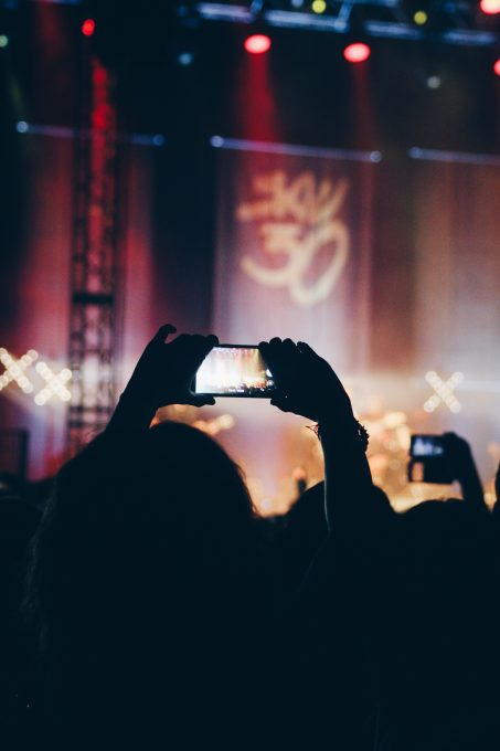 A person using a phone at a concert