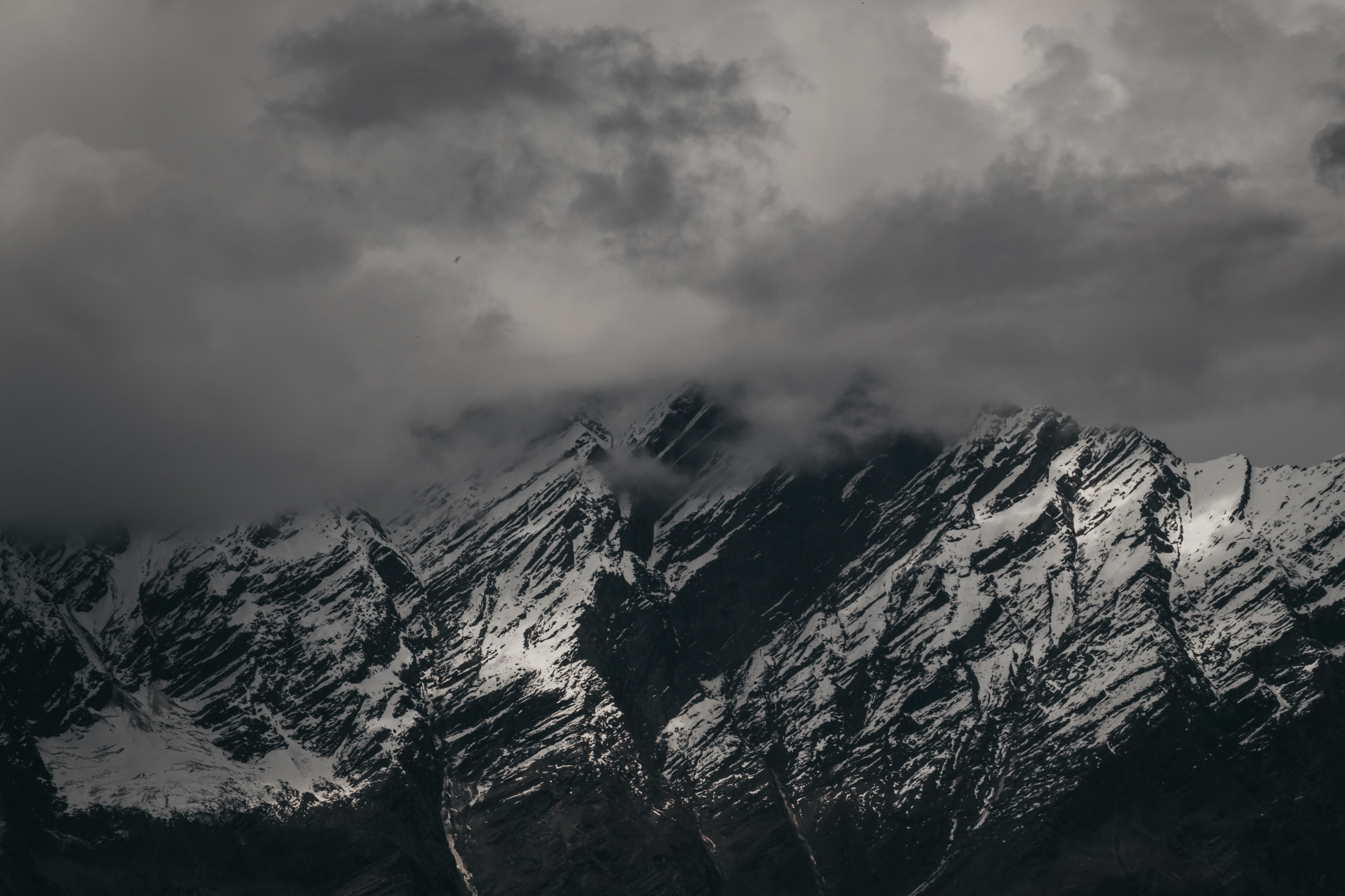 A snow-capped mountain during cloudy weather