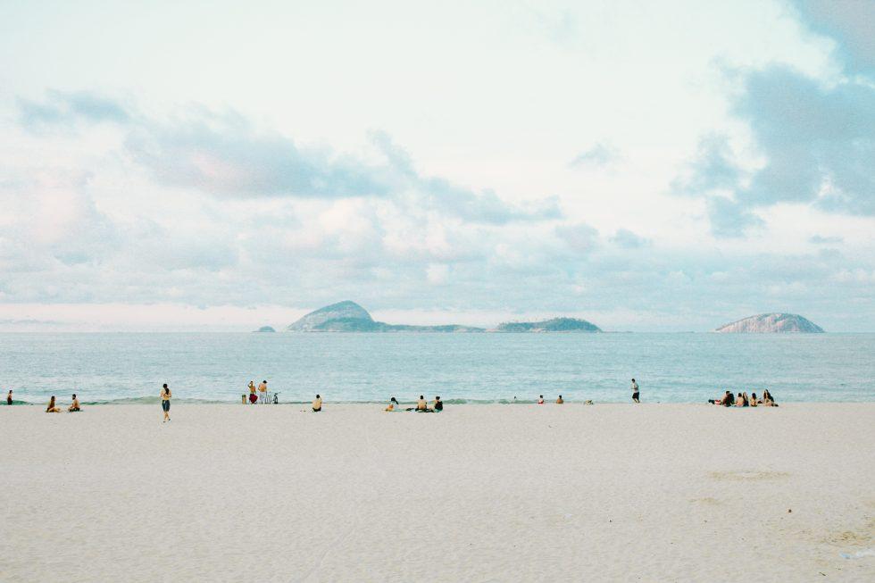 A white sand beach under a cloudy sky