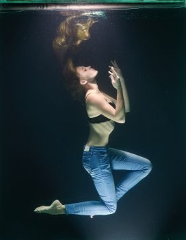 A woman in the body of water