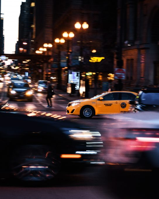A yellow cab passing on the road