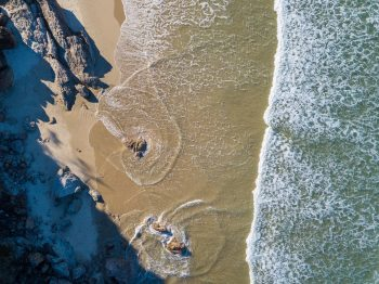 Aerial photography of sea by shore