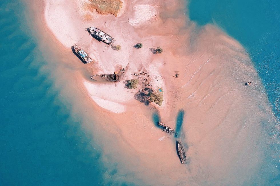 Aerial view of stranded boats surrounded by water
