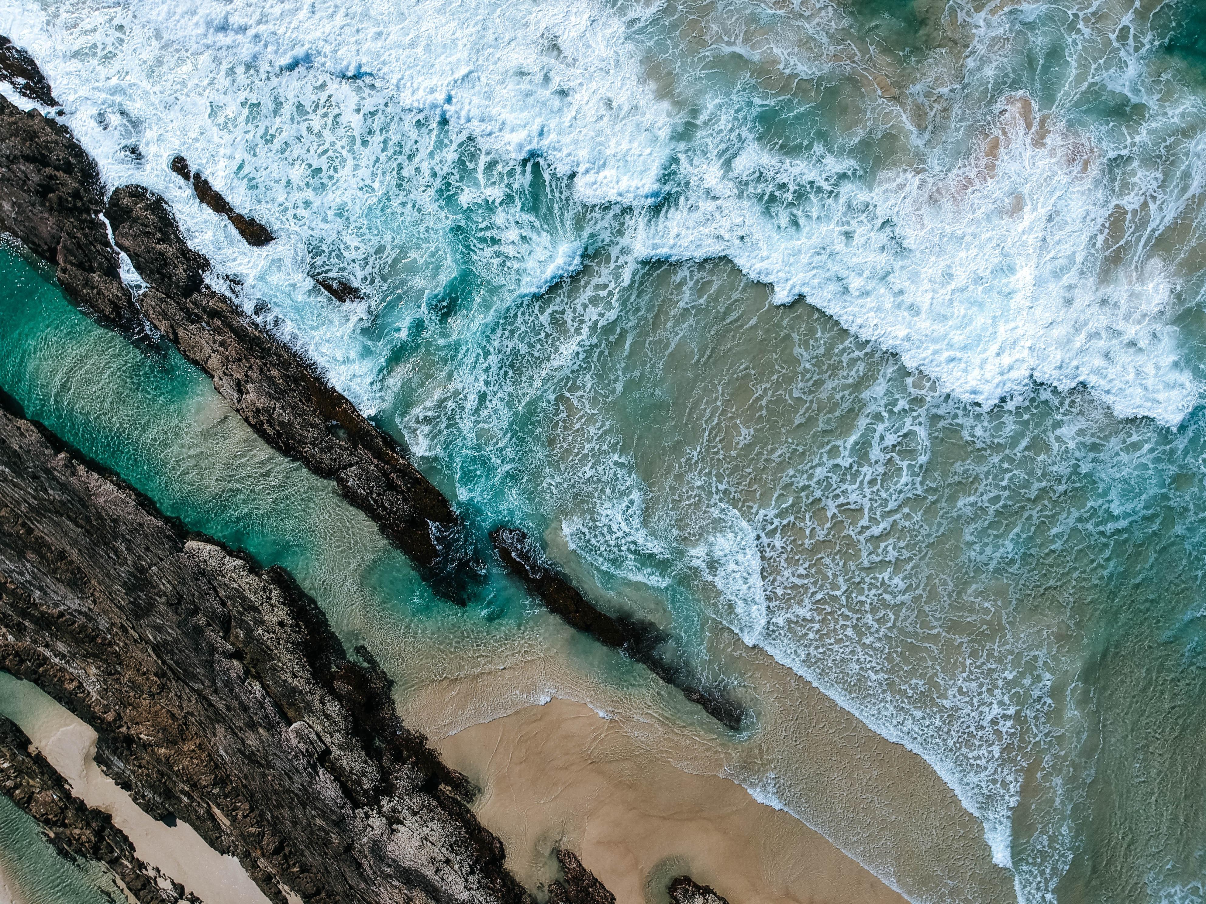 Aerial view of tidal waves of ocean coastline