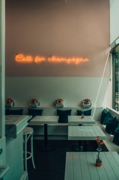 An orange neon light signage on a wall