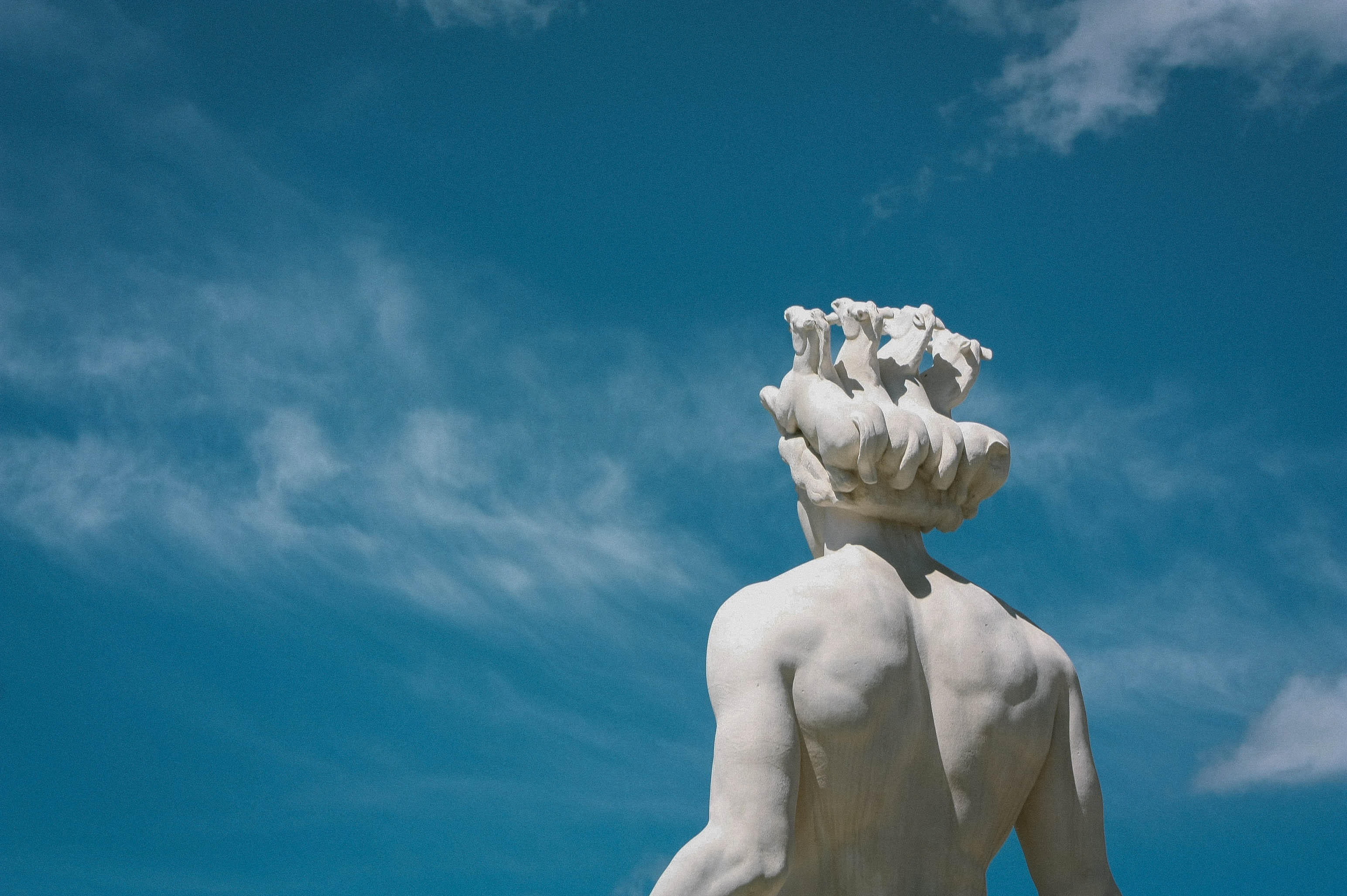 Back view of a human statue under a clear sky