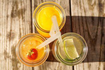 Assorted juice in glass bottles
