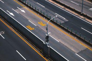 Bird's eye view photo of gray concrete road