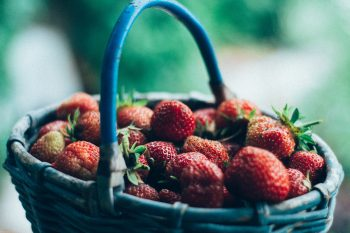 Close-up photography of a basket filled with strawberries