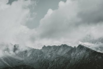 Gray mountains under clouds