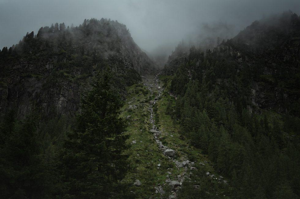 Green mountains under a fog