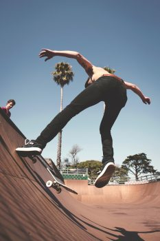 Low angle photo of a person skateboarding