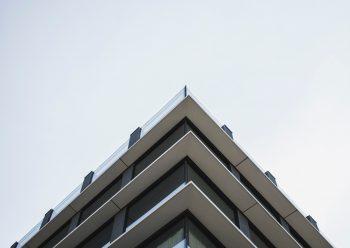 Low angle photo of a white concrete building