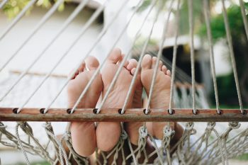 Photo of bare feet on a hammock