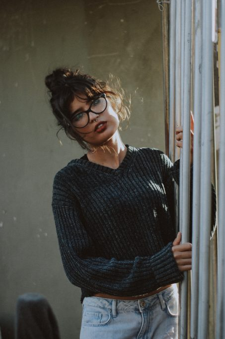 Photography of a woman wearing a gray corduroy sweater
