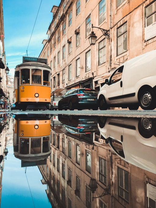 Reflection of a tram in a puddle