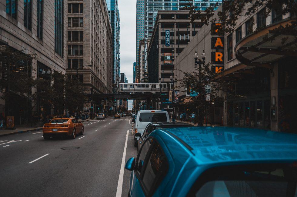 Road traffic between concrete buildings