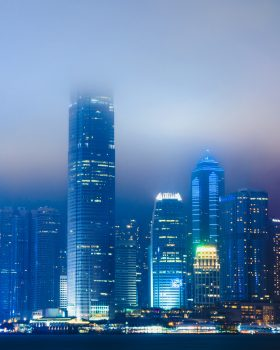 Scenic view of skyscrapers during a foggy evening