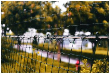 Shallow focus photography of a black net during raining
