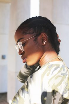 Side view photo of a woman wearing eyeglasses