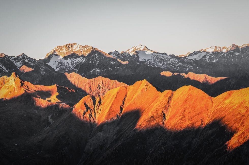 Sunlight illuminating mountain peaks during sunset