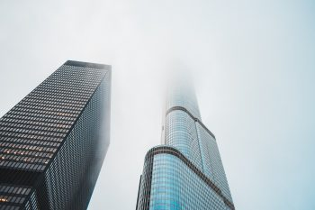 Worm's eye view of two skyscrapers under the fog