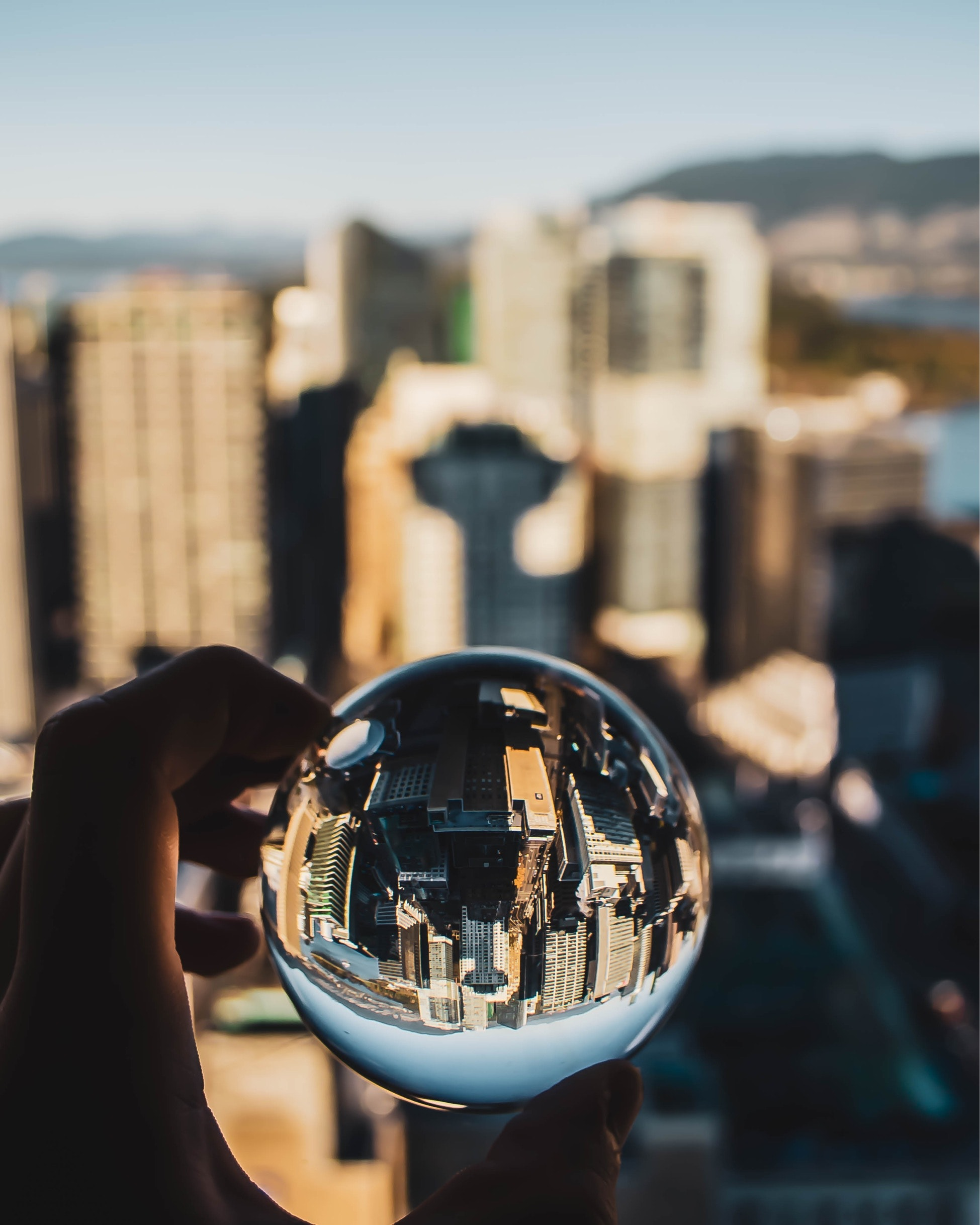 A person holding a glass ball