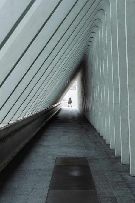 A person standing at the end of a hallway