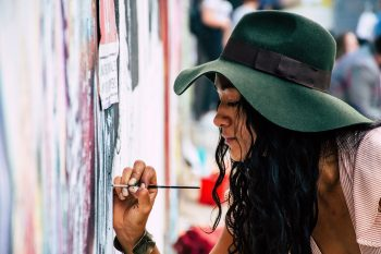A woman painting on a wall