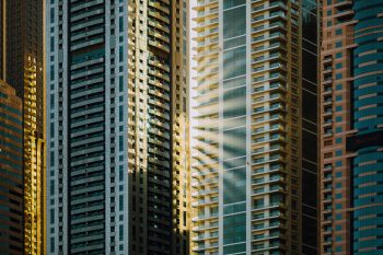 Aerial photography of sun rays on glass curtain buildings
